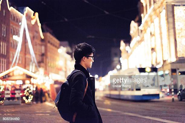 Young man walking in Christmas Market