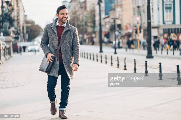 young man walking in the city - smart casual stock pictures, royalty-free photos & images