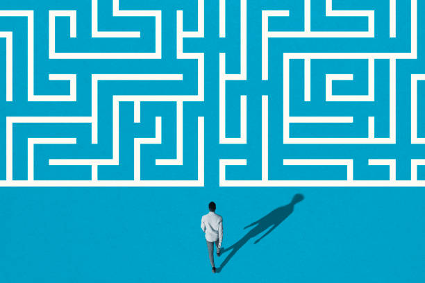 Young man walking towards white maze pattern