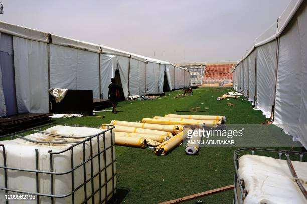 Young man walks between the male and female tents at a COVID-19 coronavirus isolation centre at the Sani Abacha stadium in Kano, Nigeria, on April 7,...