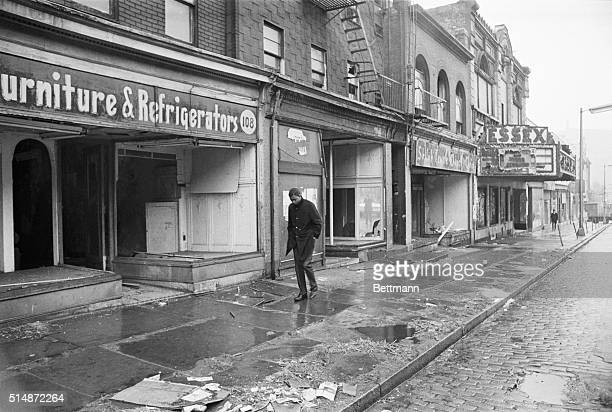 A young man walks down a looted street in Newark New Jersey on February 29 1968 The street had been damaged by rioting in July of 1967 but repair...