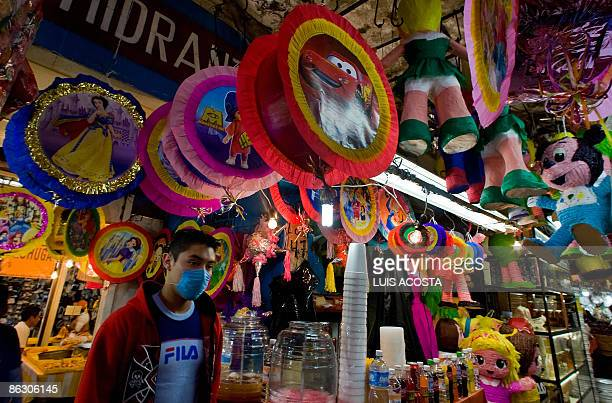 A young man wandering around La Merced market in Mexico City wears a surgical mask on April 30 2009 Mexico on Thursday sharply raised its number of...