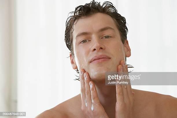 young man washing face, portrait - あご ストックフォトと画像
