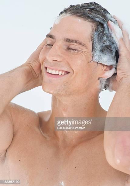 Young man washing hair