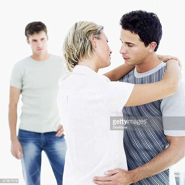 a young man watching a couple hugging - caught cheating stock pictures, royalty-free photos & images