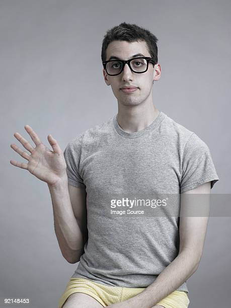 young man waving - blank expression stock pictures, royalty-free photos & images