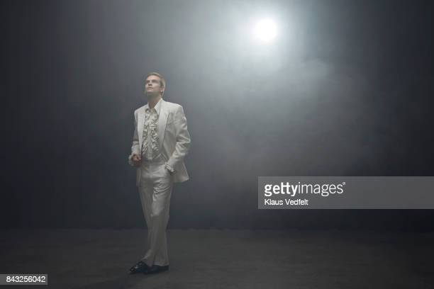 young man wearing 70' style white suit with puffy shirt - white tuxedo stock pictures, royalty-free photos & images