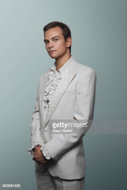 young man wearing 70' white suit and puffy shirt - elizabethan collar stock photos and pictures