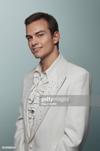 young man wearing 70' white suit and puffy shirt, smiling to camera - elizabethan collar stock photos and pictures