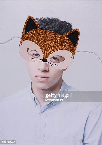 Young man wearing a cat mask