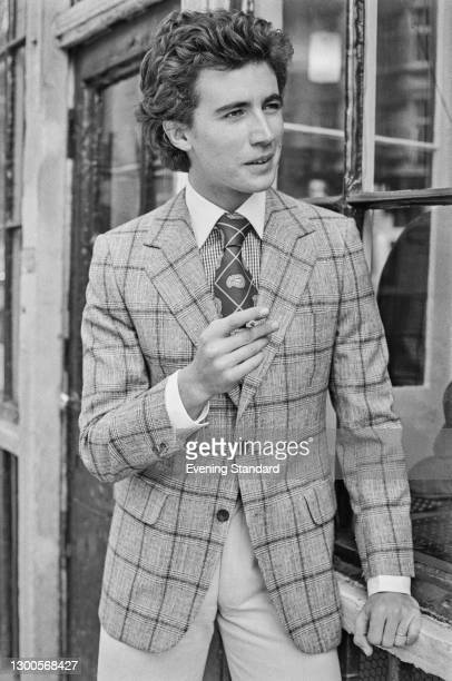 Young man wearing a checked jacket and a tie, UK, 2nd May 1973.