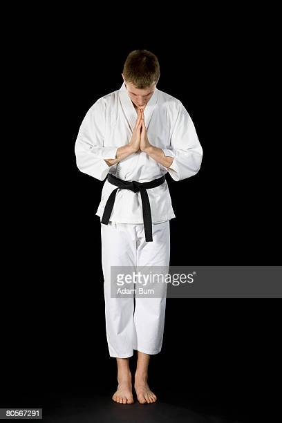 A young man wearing a karate suit