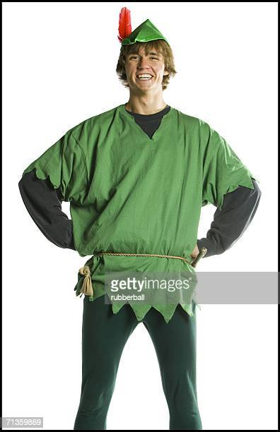 Young man wearing a Robin Hood costume with his hands on his hips