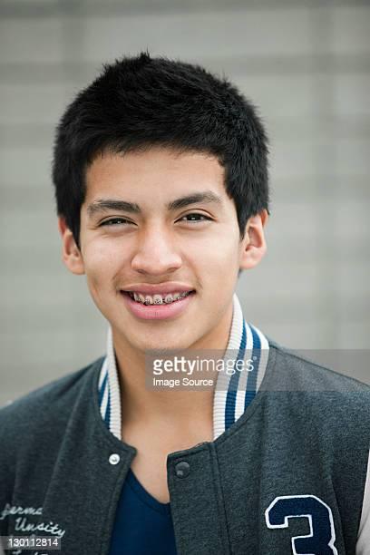 young man wearing baseball jacket, portrait - endast tonårspojkar bildbanksfoton och bilder
