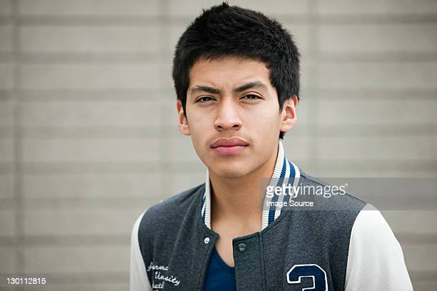Young man wearing baseball jacket, portrait