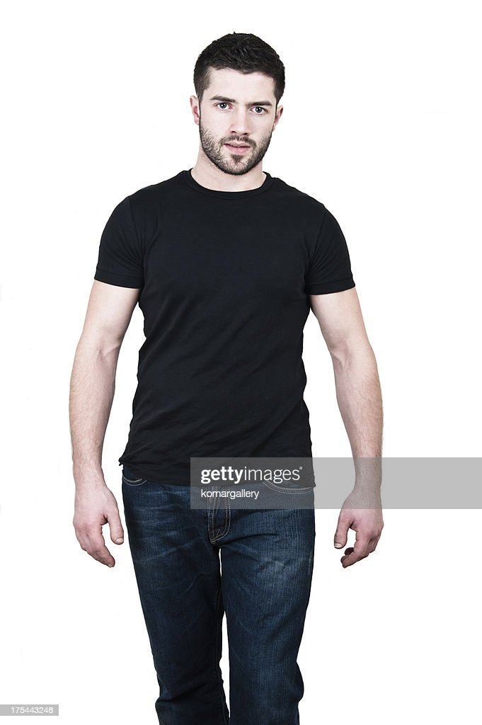 young man wearing black t shirt and jeans stock photo