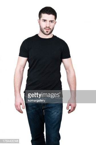 Young man wearing black t shirt and jeans stock photo for Shirts that go with black jeans