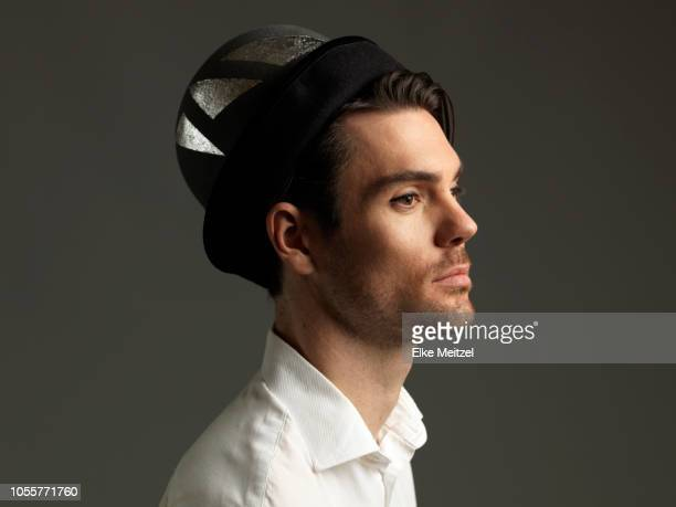 young man wearing bowler hat - arrogance stock pictures, royalty-free photos & images