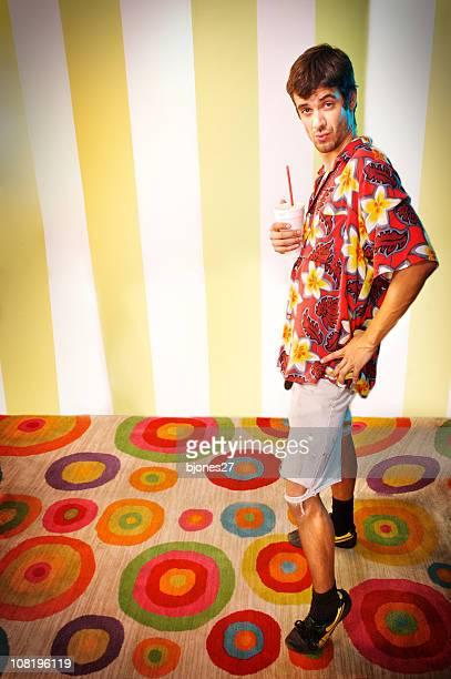 Young Man Wearing Crazy Hawaiian Shirt Posing