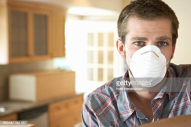 Young man wearing dust mask, portrait