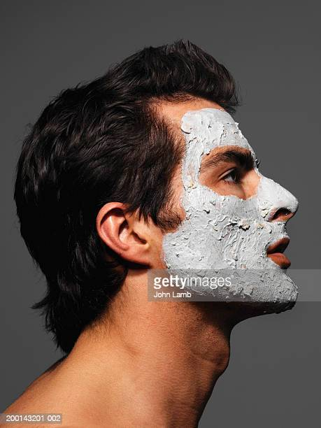 Young man wearing face pack, profile