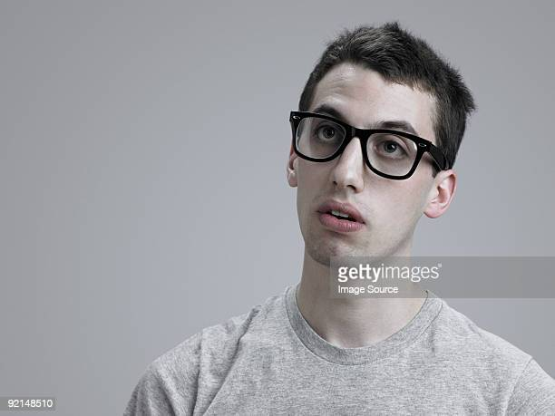 young man wearing glasses - blank expression stock pictures, royalty-free photos & images