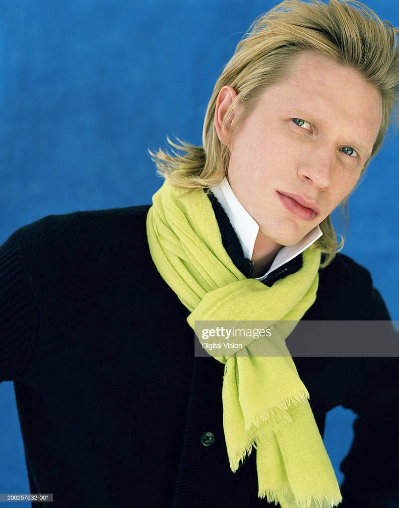 Young man wearing green scarf, portrait, close-up : Stock Photo