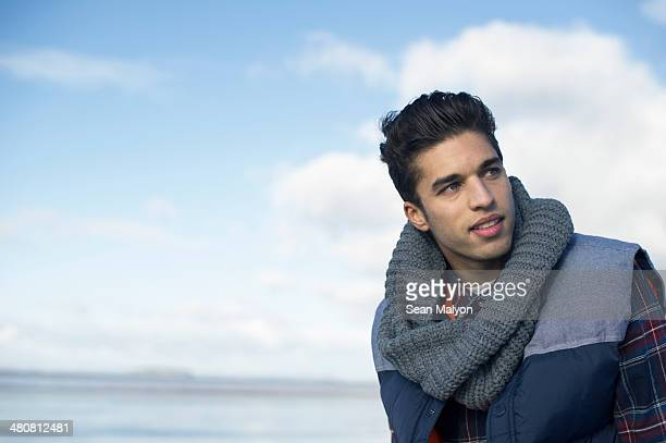 young man wearing grey scarf - sean malyon stock pictures, royalty-free photos & images
