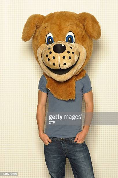 Young man wearing head of dog costume