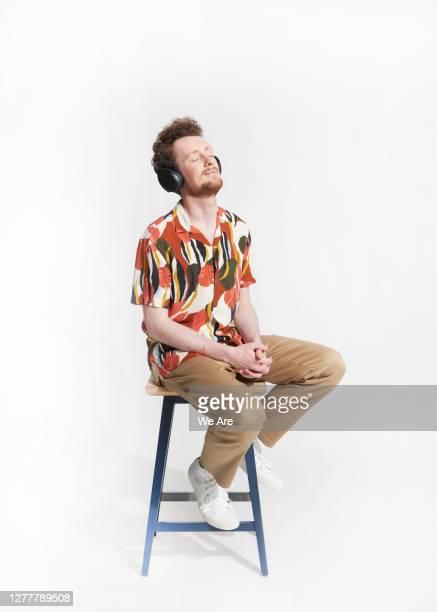 young man wearing headphones - ビジネスウェア ストックフォトと画像