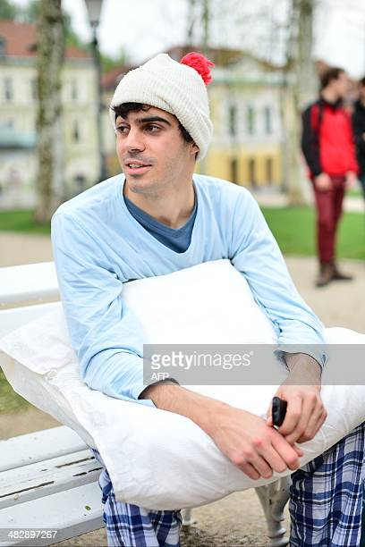 A young man wearing his pajamas waits for the start of the pillow fight on an International Pillowfight Day in Ljubljana Slovenia on April 5 2014 AFP...