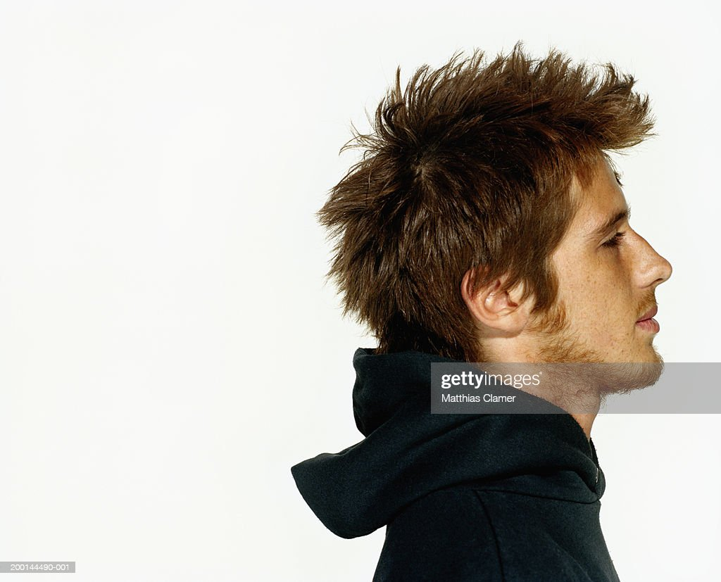 Young man wearing hooded sweater, profile, close up : Stock-Foto