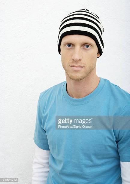 Young man wearing knit hat, portrait