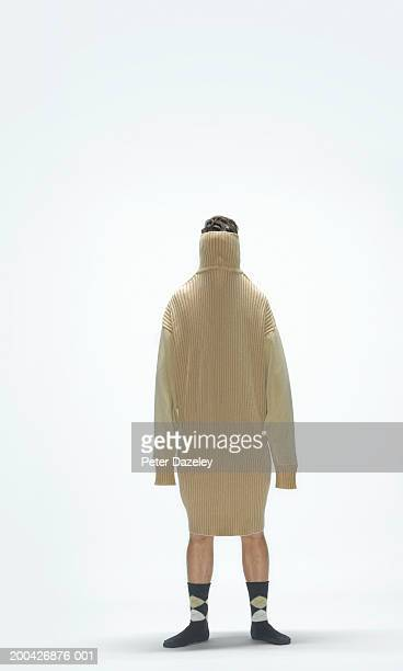 young man wearing large jumper over head and body - caucasian appearance stock pictures, royalty-free photos & images