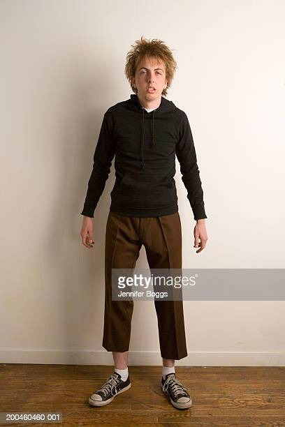 Young man wearing pants too short