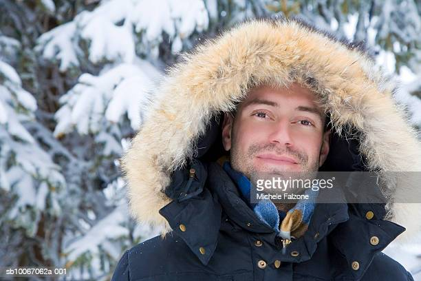 young man wearing parka, smiling, portrait - parka coat stock pictures, royalty-free photos & images