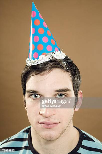 Young man wearing party hat, portrait