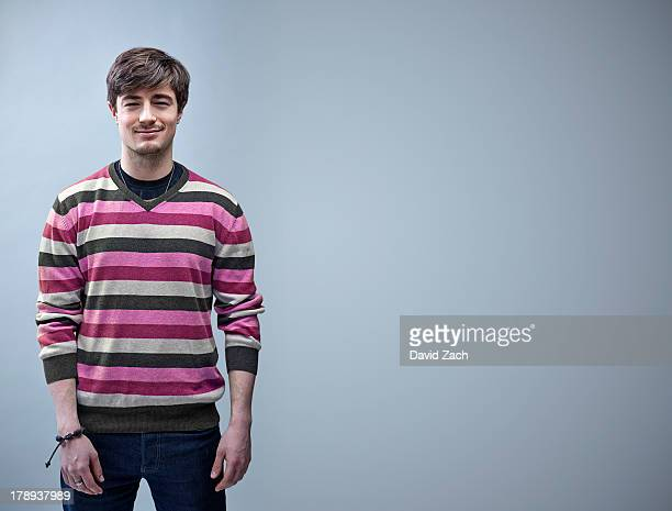 Young man wearing stripped sweater, portrait