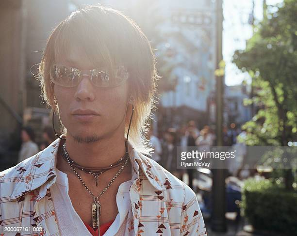 Young man wearing sunglasses, portrait