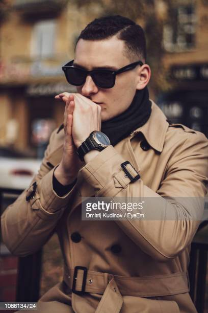 young man wearing sunglasses while standing outdoors - suave stock pictures, royalty-free photos & images
