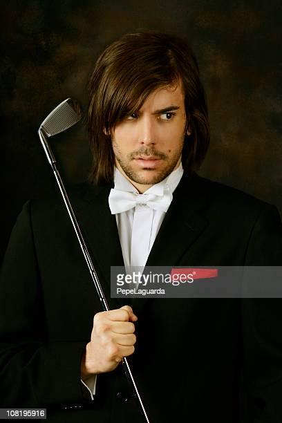 若い男性のタキシードを着て、ゴルフの