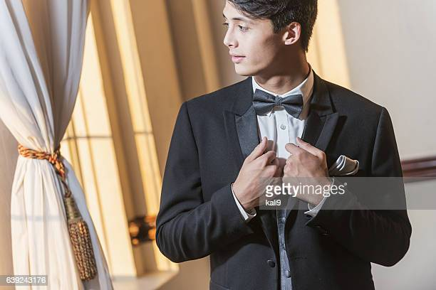 young man wearing tuxedo - タキシード ストックフォトと画像