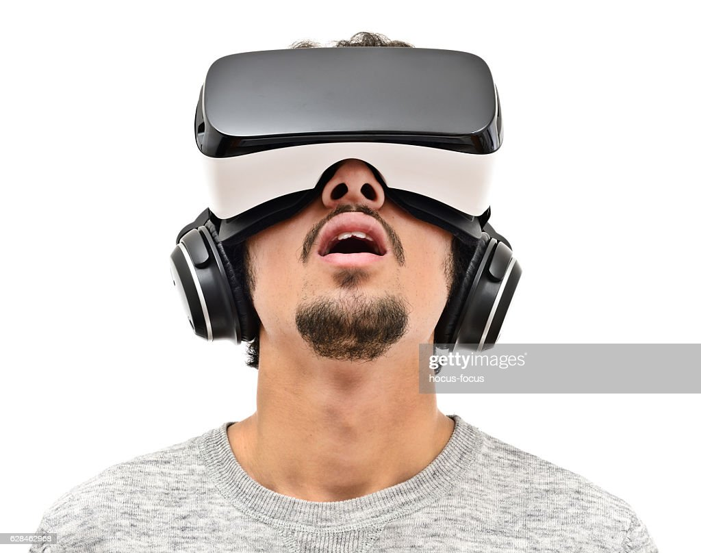 Young man wearing vr headset : Stock Photo