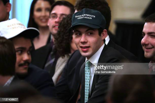 A young man wears a 'Make Dartmouth Great Again' hat before US President Donald Trump signs an executive order protecting freedom of speech on...