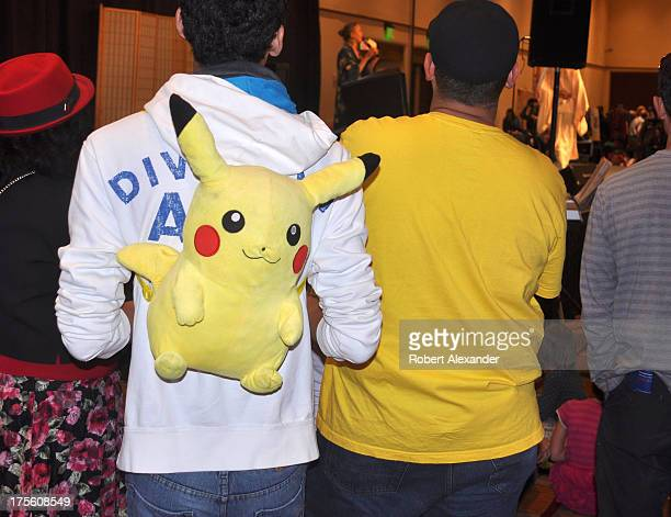 A young man wears a Pokemon backback at an event in Santa Fe New Mexico