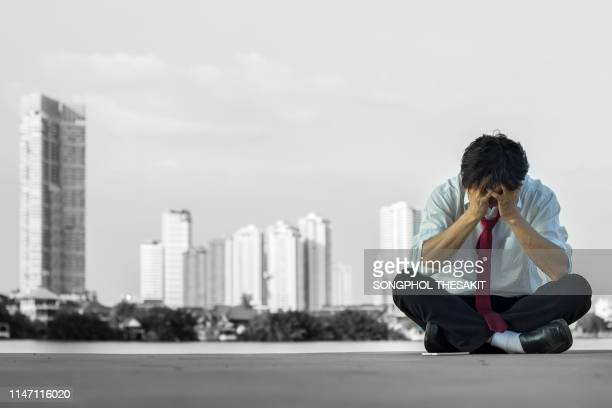 a young man who is worried and stressed that is unemployed he has no job, no money, and no future. - suicídio imagens e fotografias de stock