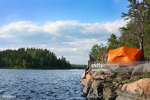 young man wilderness camping - boundary waters canoe area stock pictures, royalty-free photos & images