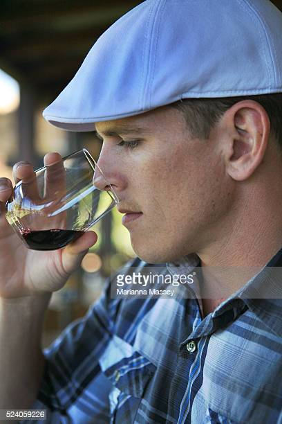 A young man wine tasting at Laurance winery in the Margaret River Wine Region Margaret River is a town and river in the South West of Western...