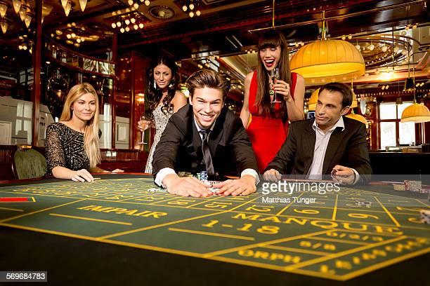 Young man winning the whole jackpot