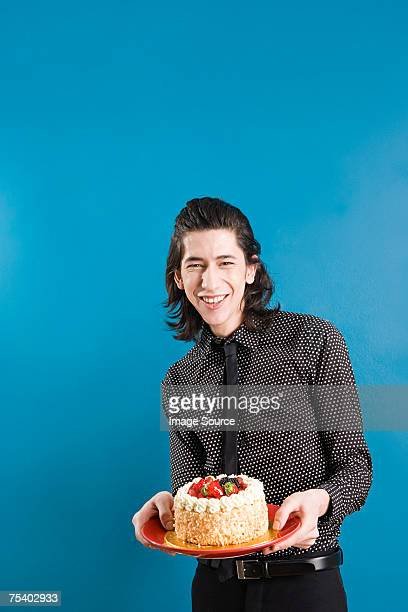 Young man with a cake
